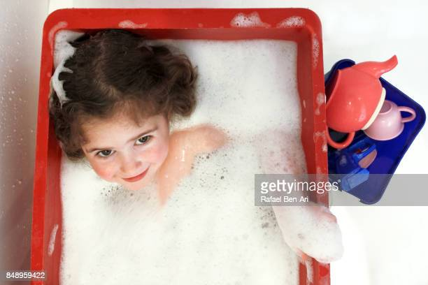 little girl having a bath - rafael ben ari stockfoto's en -beelden