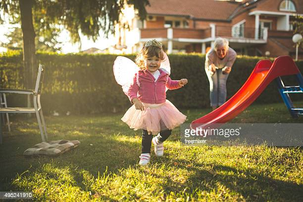 little girl having a great time with grandmother - princess stock pictures, royalty-free photos & images