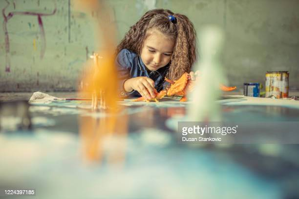 little girl having fun in an art studio - dusan stankovic stock pictures, royalty-free photos & images