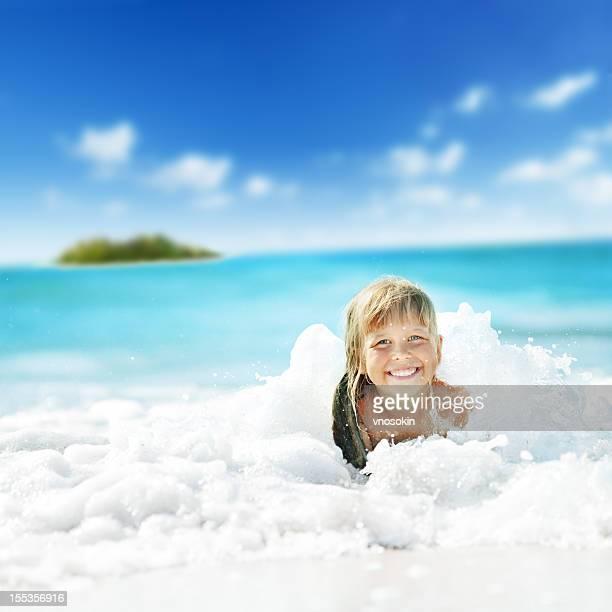 Little girl having fun in ocean