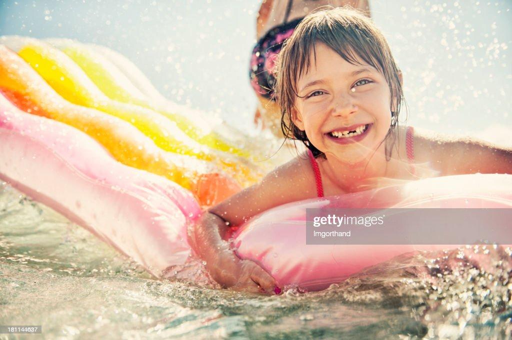 Little girl having fun in sea : Stock Photo