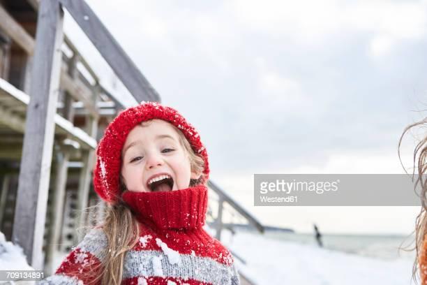 Little girl having fun in winter, portrait