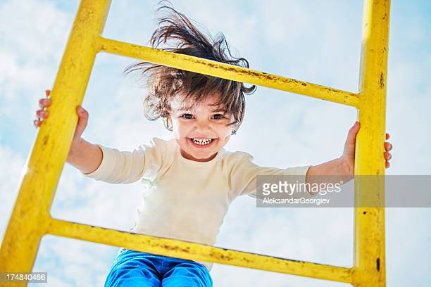 Little Girl Having Fun on a Playground