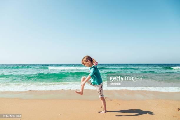 little girl having fun on mediterranean beach - haifa stock pictures, royalty-free photos & images