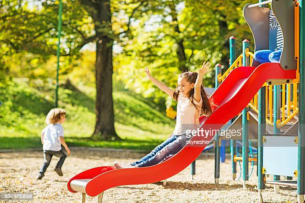 Little girl having fun while sliding.