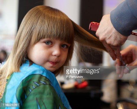 little girl having her first hair cut highres stock photo