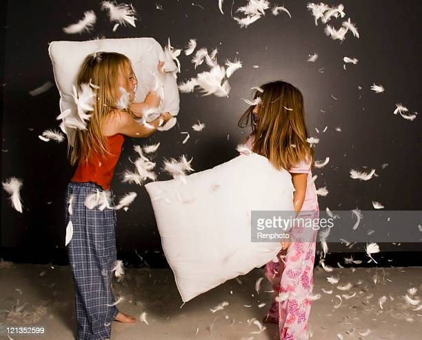 Little girl having pillow fight
