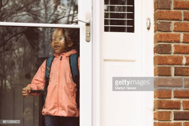 little girl headed to school - open backpack stock pictures, royalty-free photos & images