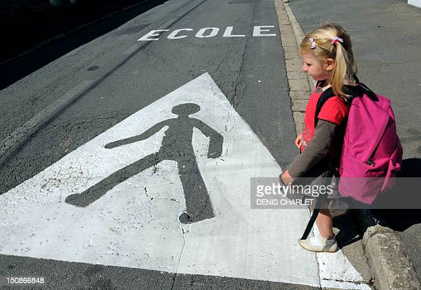 A little girl heads to school in Verquin northern France on August 28 a few days of the start of classes AFP PHOTO / DENIS CHARLET