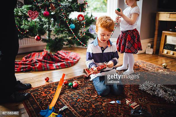 Little Girl Helping Grandma Decorate the Tree