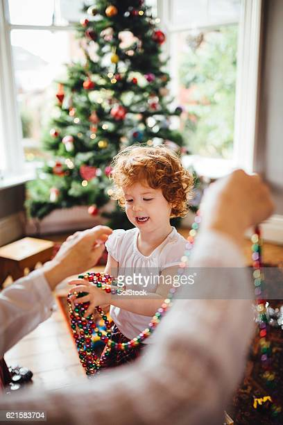 Little Girl Helping Grandma with the Christmas Decorations