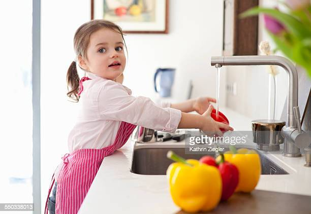 little girl helping in the kitchen