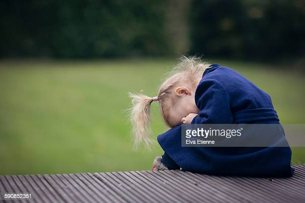 little girl hiding her face in her hands - tantrum stock photos and pictures
