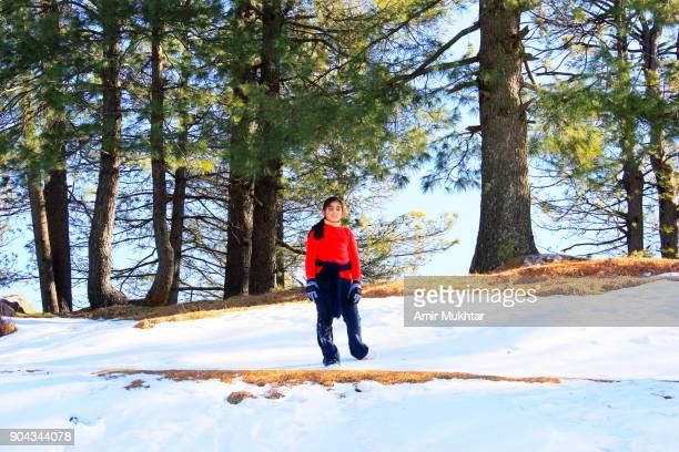 A Little Girl Hiking / Walking On Snow