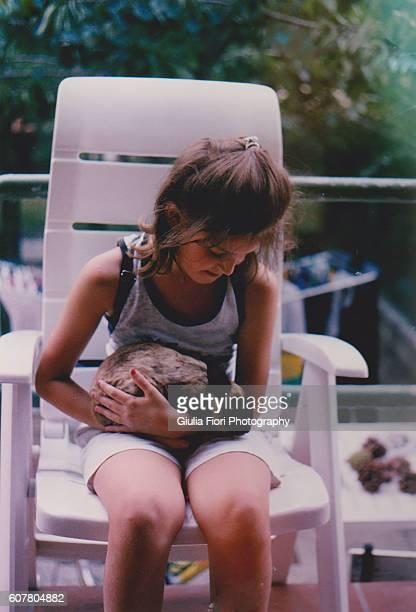little girl holding a rabbit - 1990~1999年 ストックフォトと画像