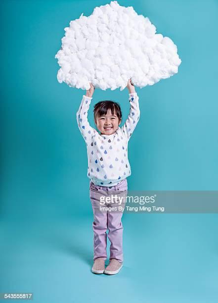 Little girl holding DIY data cloud over her head