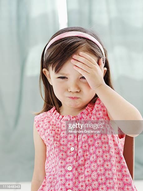 Little Girl Holding Head