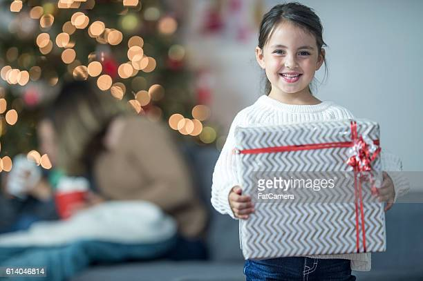 Little Girl Holding Her Gift