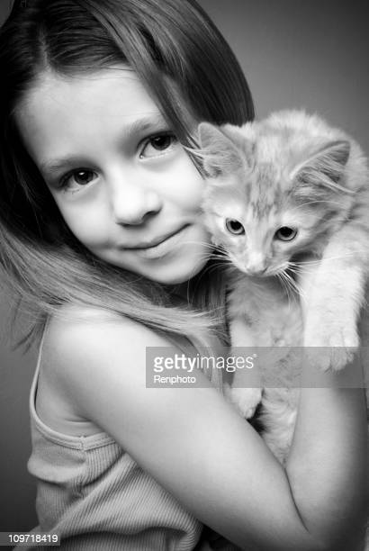 Little Girl Holding Her Kitty