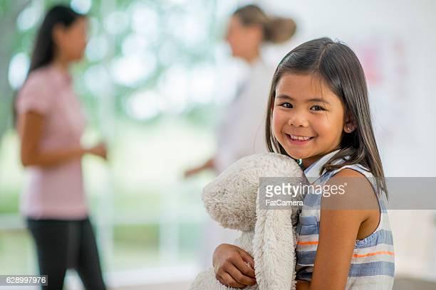 Little Girl Holding Her Stuffed Animal