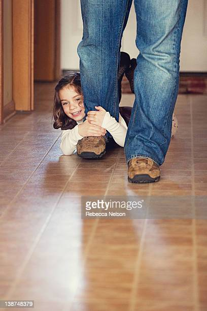 little girl holding on to her dadd's leg - rebecca nelson stock pictures, royalty-free photos & images