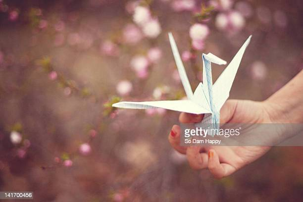 Little girl holding paper crane