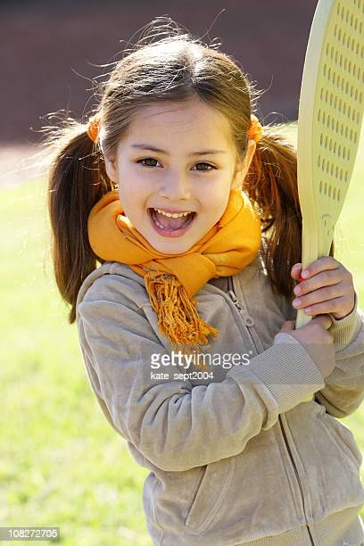 little girl holding racket - innocence stock pictures, royalty-free photos & images