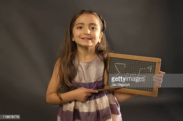 little girl holding small blackboard with formula - depczyk stock pictures, royalty-free photos & images