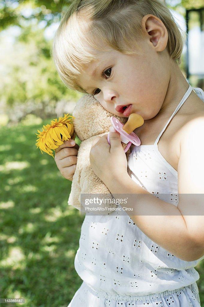 Little Girl Holding Flower — Stock Photo © monkeybusiness