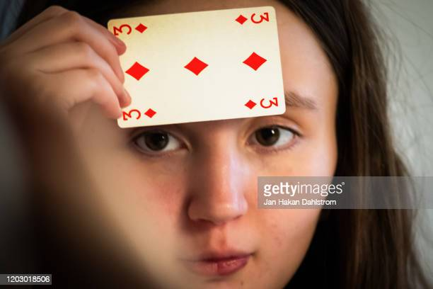 little girl holding three  of diamonds playing card - skin diamond stock pictures, royalty-free photos & images