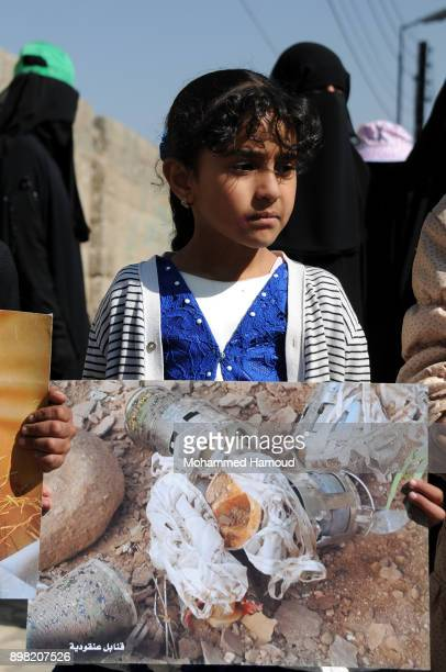 A little girl holds a picture of parts of a missile during a rally staged against the ongoing 1000day war on Yemen by the Saudiled coalition outside...
