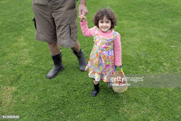 little girl holds grandfather hands - rafael ben ari stock pictures, royalty-free photos & images
