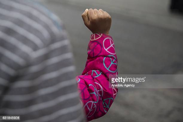 A little girl holds up her fist in respect as they watch the Martin Luther King Day Parade in memory of the Civil Rights leaders birthday in...