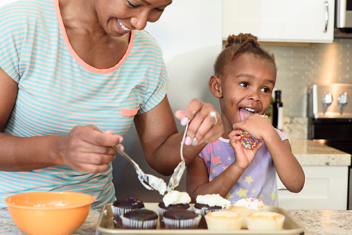 Little girl home baking with her mother - gettyimageskorea