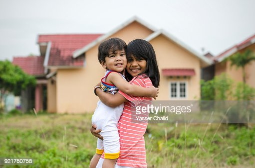Little Girl Hugging Baby Boy