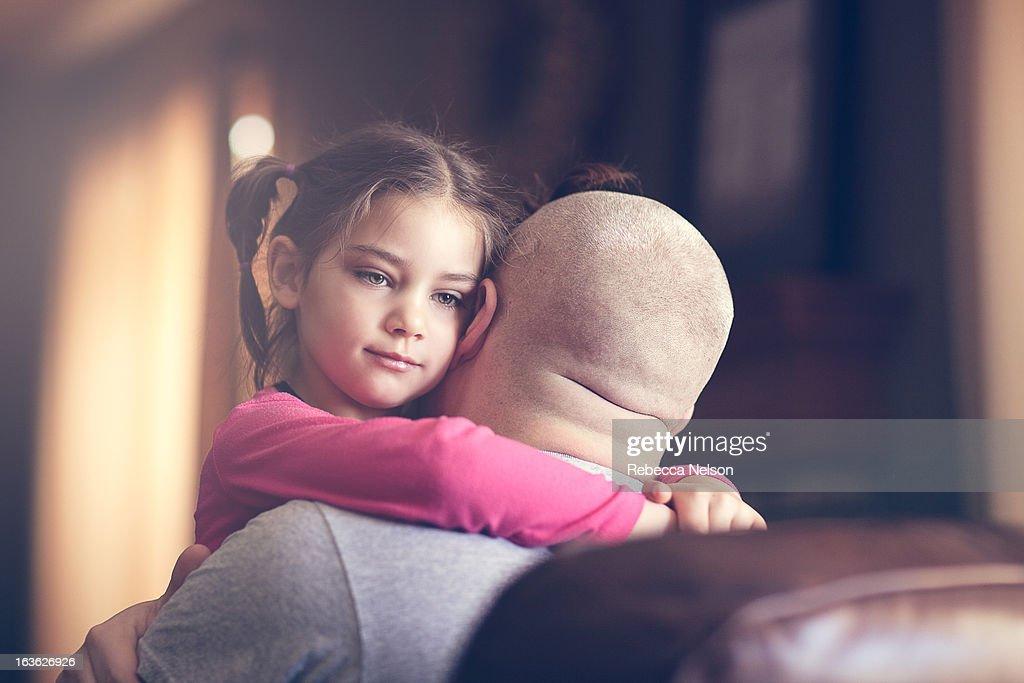 little girl hugging her dad : Stock Photo