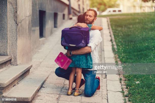 little girl hugging her father before going to school - first day of school stock pictures, royalty-free photos & images