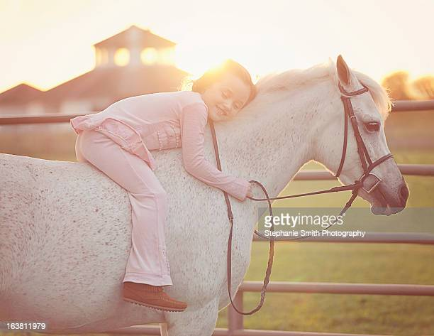 Little Girl Hugging her Horse