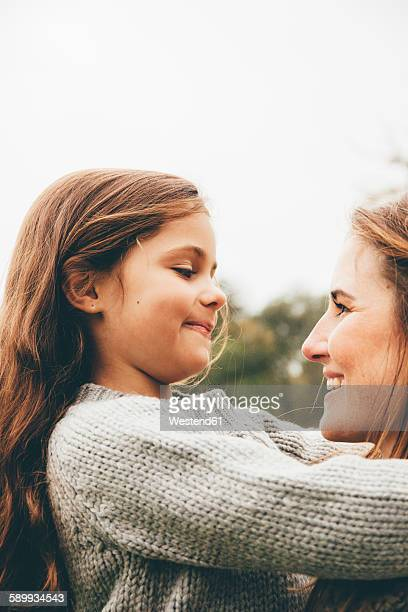little girl hugging her mother - wool stock pictures, royalty-free photos & images