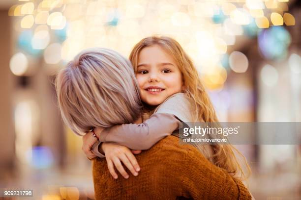 little girl hugging her mum - affectionate stock pictures, royalty-free photos & images
