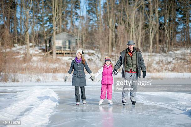 Little Girl Ice Skating with Her Parents