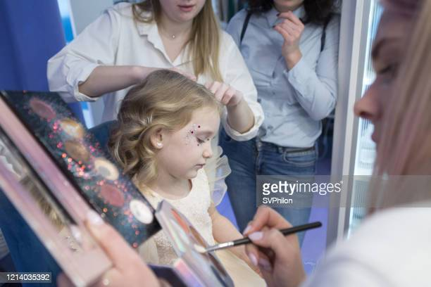 little girl in a beauty salon. - beauty salon ukraine stock pictures, royalty-free photos & images
