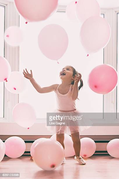 little girl in a pink world - pink dress stock photos and pictures
