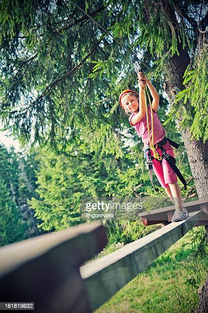 little girl in adventure park - imgorthand stock photos and pictures