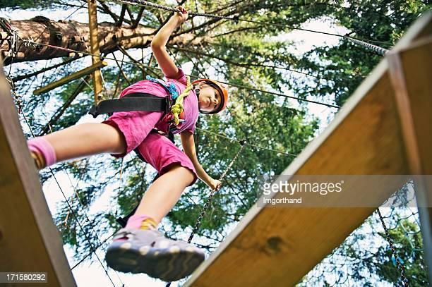 Little girl in adventure park