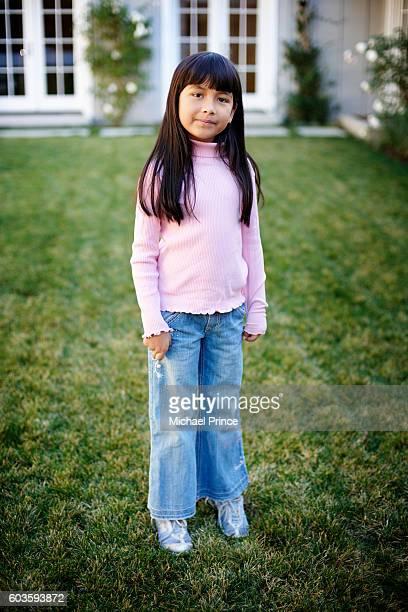 Little Girl in Backyard