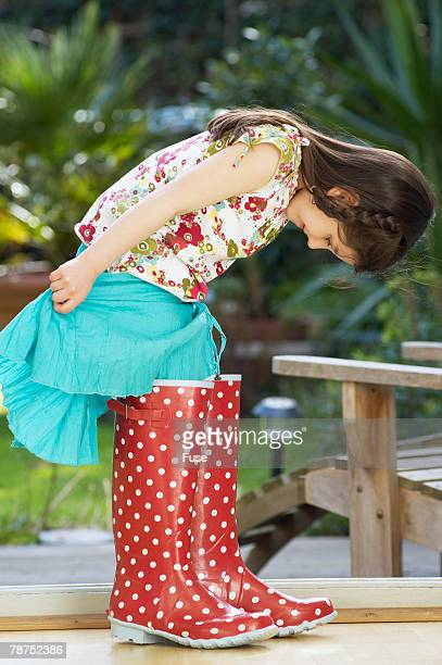 little girl in big galoshes - mismatch stock pictures, royalty-free photos & images