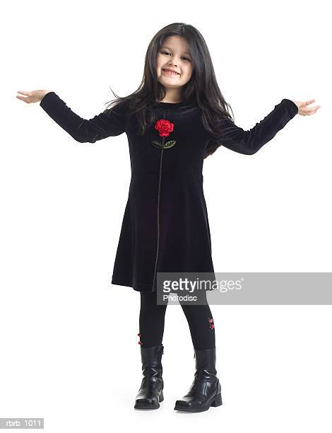 little girl in black dress holds out her arms and shrugs - funny black girl ストックフォトと画像