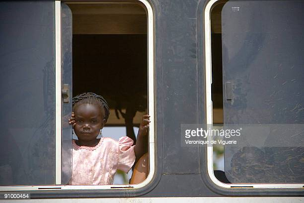 A little girl in bus at the border between Burkina Faso and Ivory Coast Hundreds of children are coming from poorer neighbouring countries like Mali...