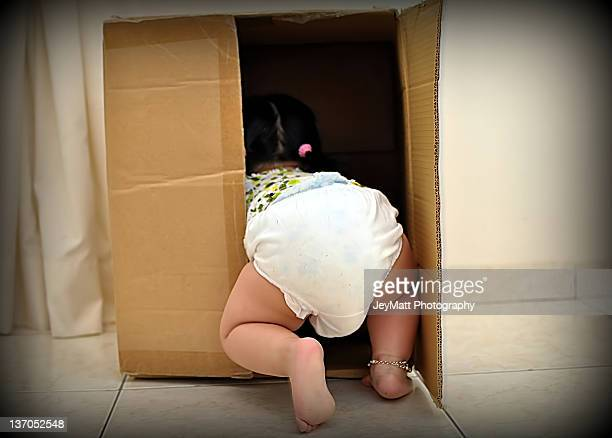 Little girl in cardboard box